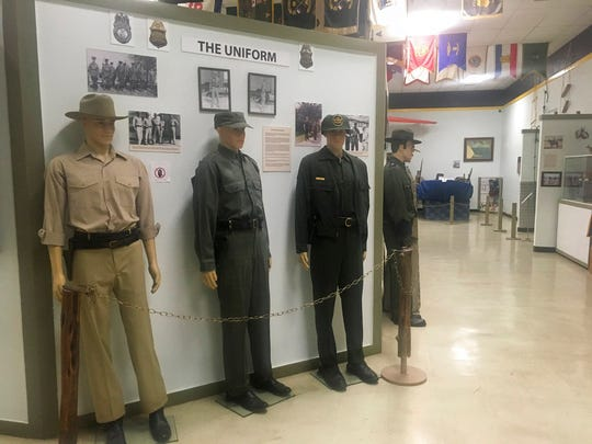 In this Nov. 29, 2018 photo, U.S. Border Patrol uniforms throughout the years are on display at a museum dedicated to the border patrol in El Paso.