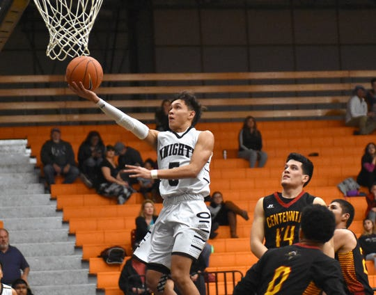 Oñate's Ricky Lujan goes in for an uncontested lay up against Centennial High School on Tuesday night.
