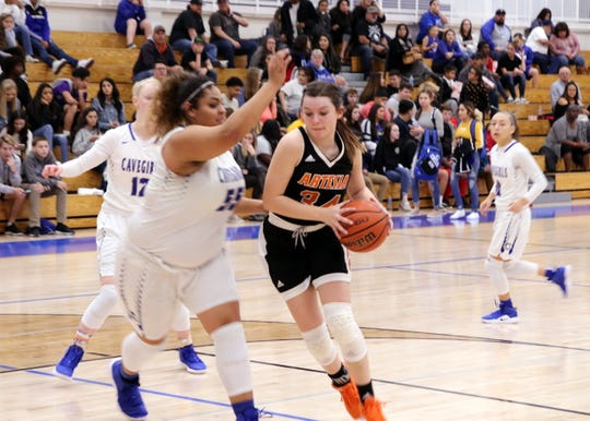 Artesia's Paityn Houghtaling (34) drives against Carlsbad's Kaliyah Montoya (55) during Tuesday's game. Houghtaling finished with 10 points