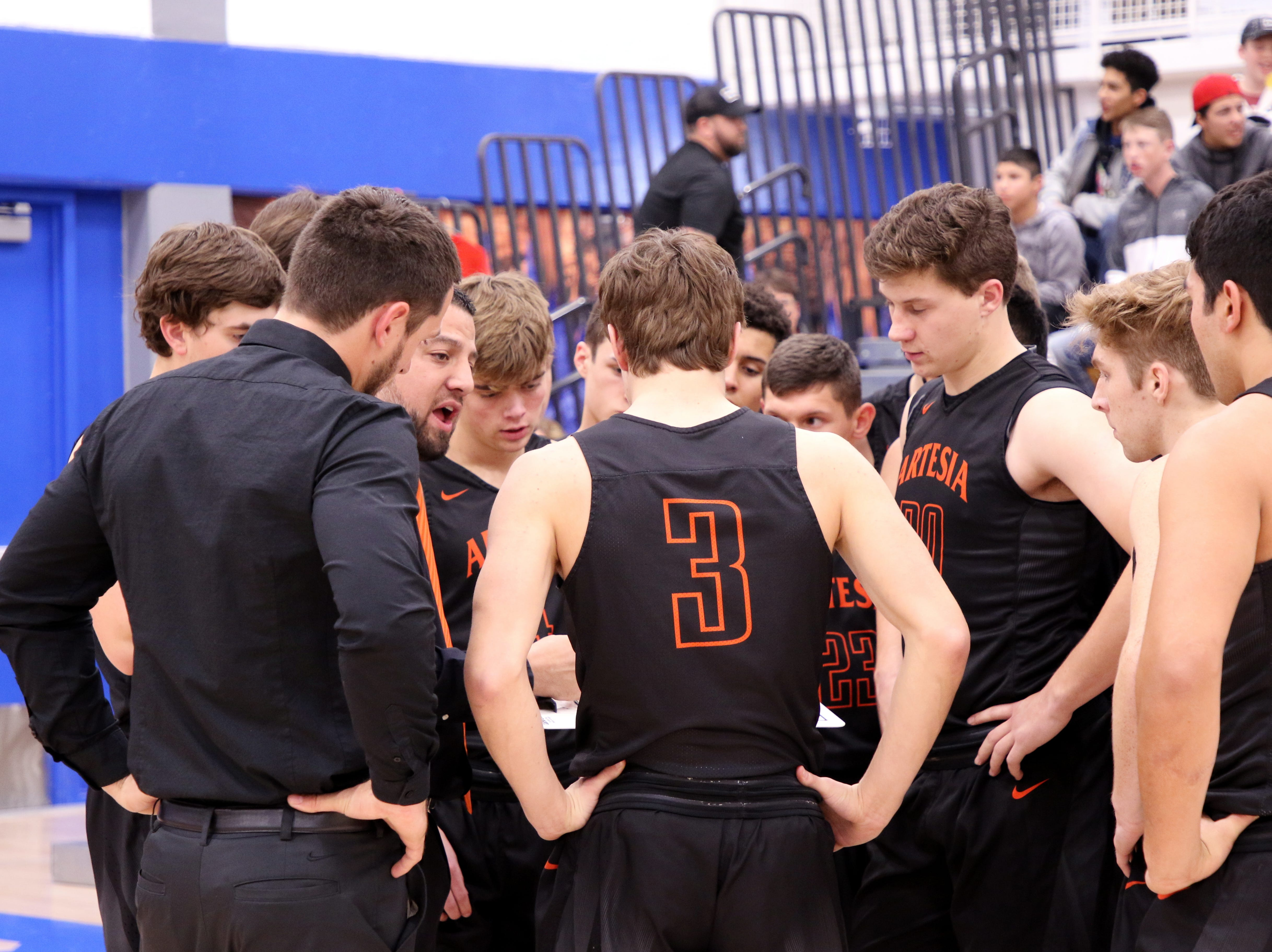 Artesia head coach Michael Mondragon talks to his team during a timeout in Tuesday's game against Carlsbad.
