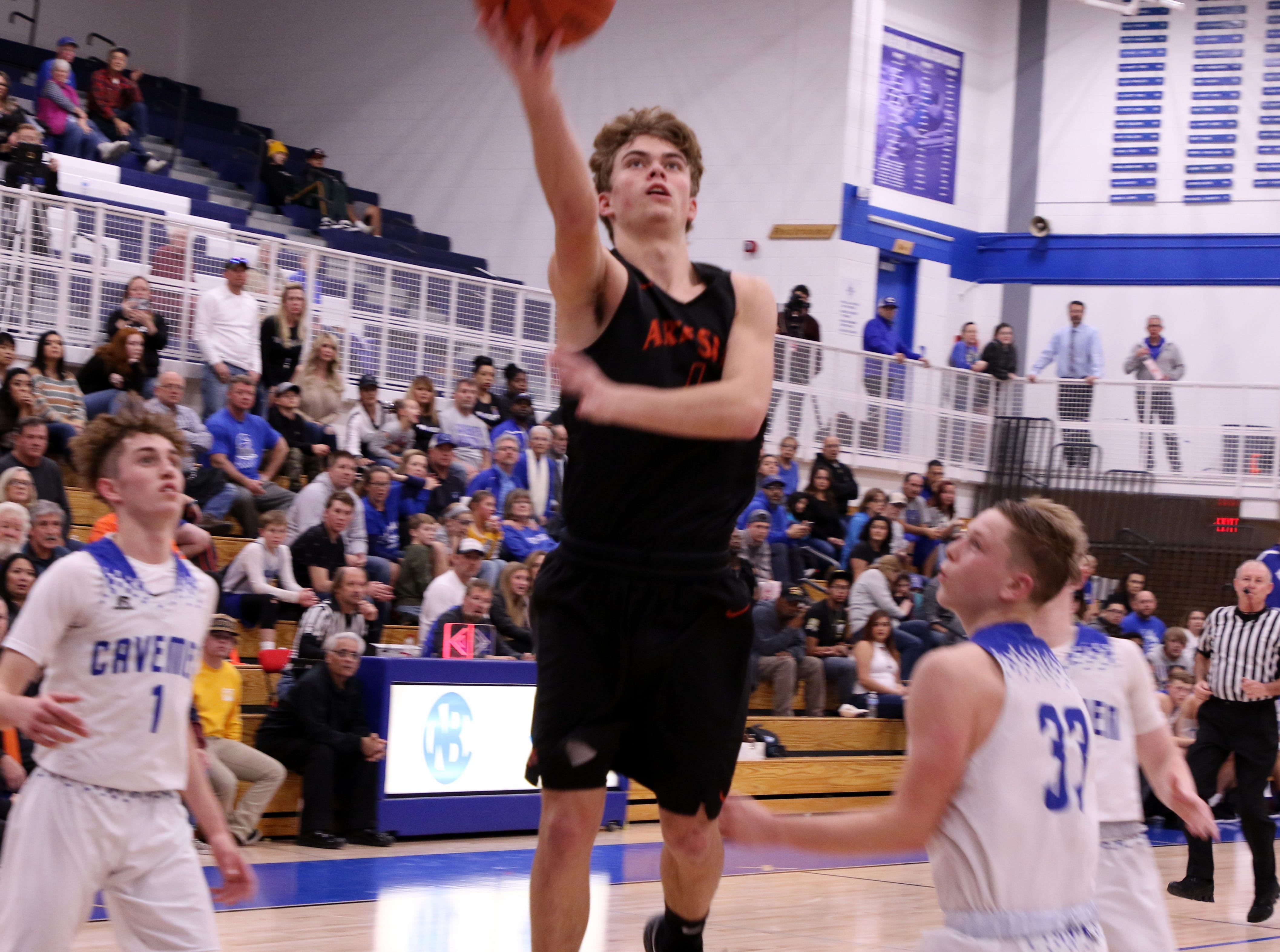 Kale Mauritsen (4) goes for a layup against Carlsbad during Tuesday's game. Mauritsen led Artesia with 17 points.