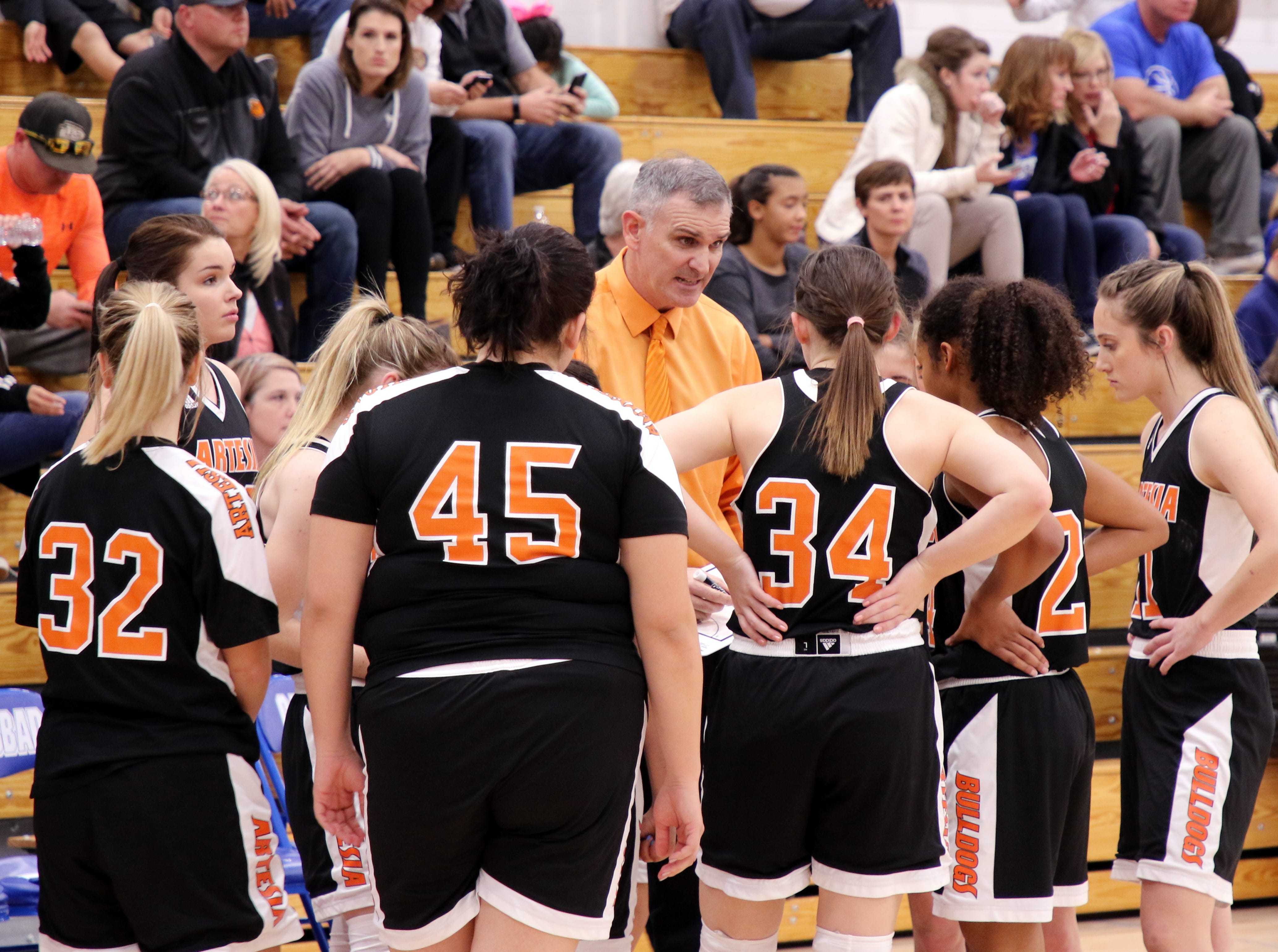 Artesia coach Jeff Houghtaling talks to his team during a timeout in Tuesday's game against Carlsbad.