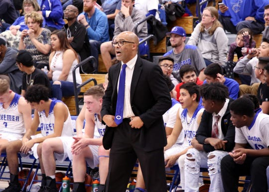 Carlsbad coach Jamaal Brown yells instructions to his players during Tuesday's game against Artesia.