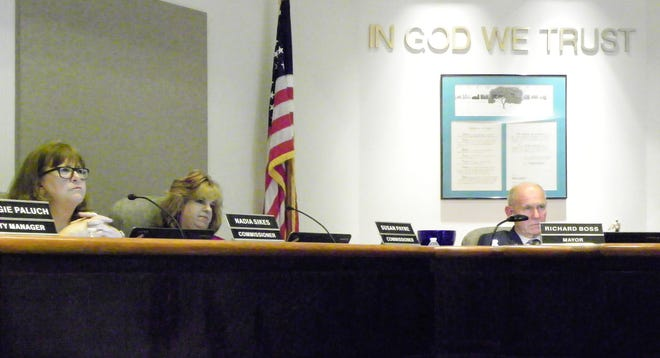 From left, Alamogordo City Commissioners Nadia Sikes, Susan Payne and Alamogordo Mayor Richard Boss listen to code of conduct complainant Rick Merrick state his case.