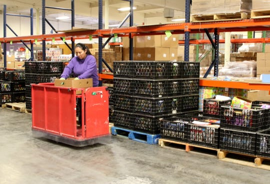 LaDonna Begay works in the warehouse Wednesday at the ECHO Food Bank in Farmington.