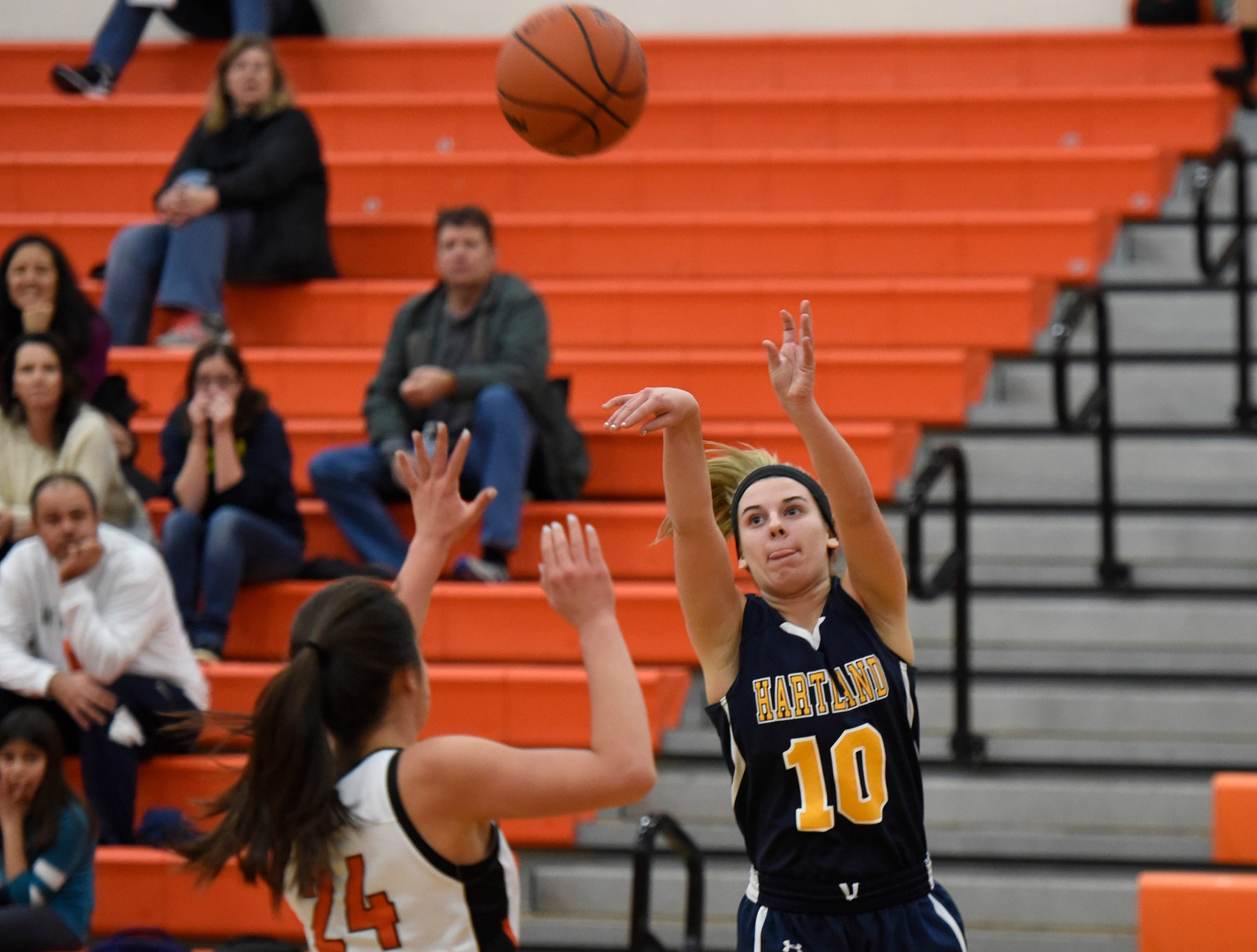 Hartland's Grace Metz (24) shoots over Northville's Nicole Martin (24) during a KLAA match up between the Mustangs and Eagles at Northville Jan. 8, 2019