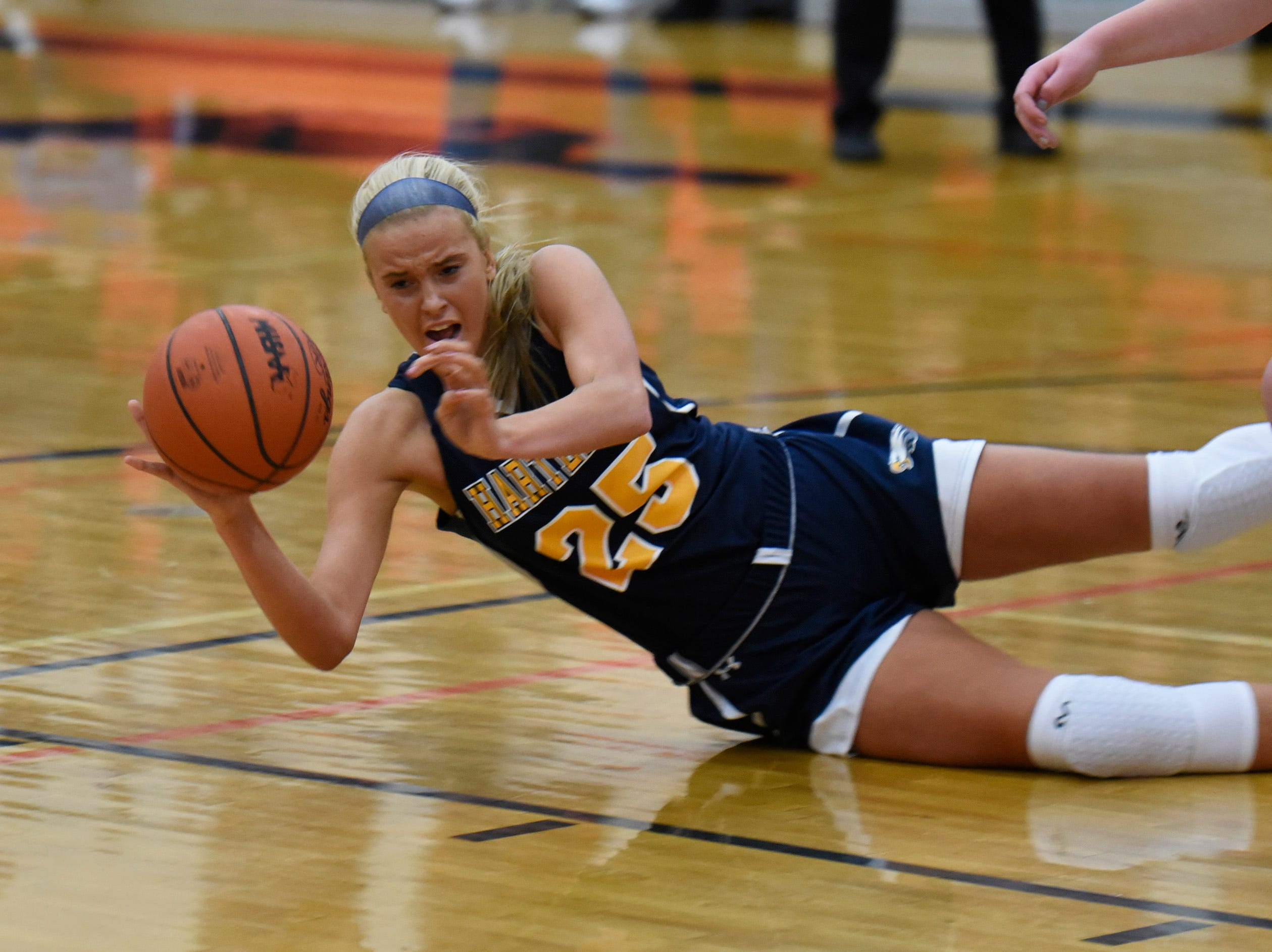 Hartland's Whitney Sollom (25) goes to the floor for the ball during a KLAA match up between the Mustangs and Eagles at Northville Jan. 8, 2019