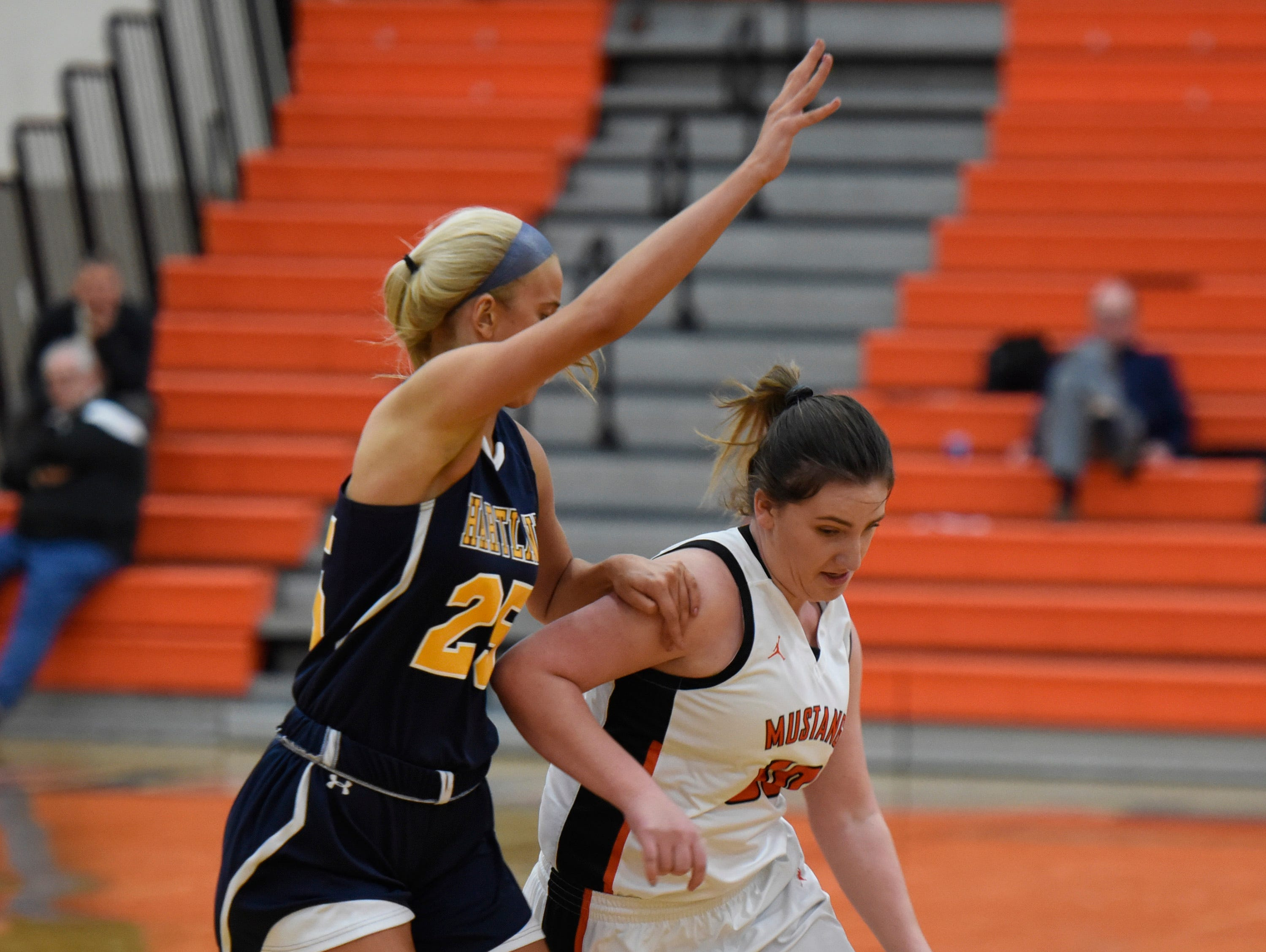 Hartland's Whitney Sollom (25) and Northville's Julia Straky (50) during a KLAA match up between the Mustangs and Eagles at Northville Jan. 8, 2019
