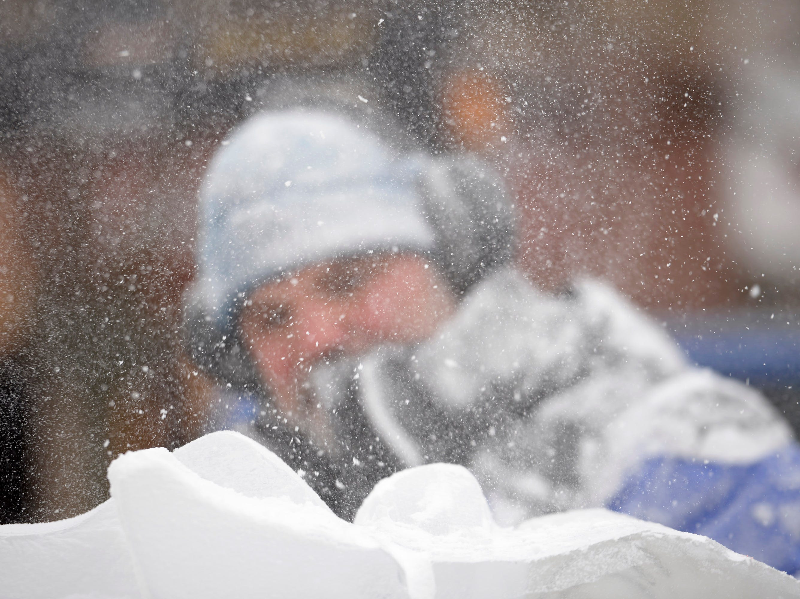 Aaron Costic works on an ice carving at the Plymouth Ice Festival that runs Jan. 11-13.