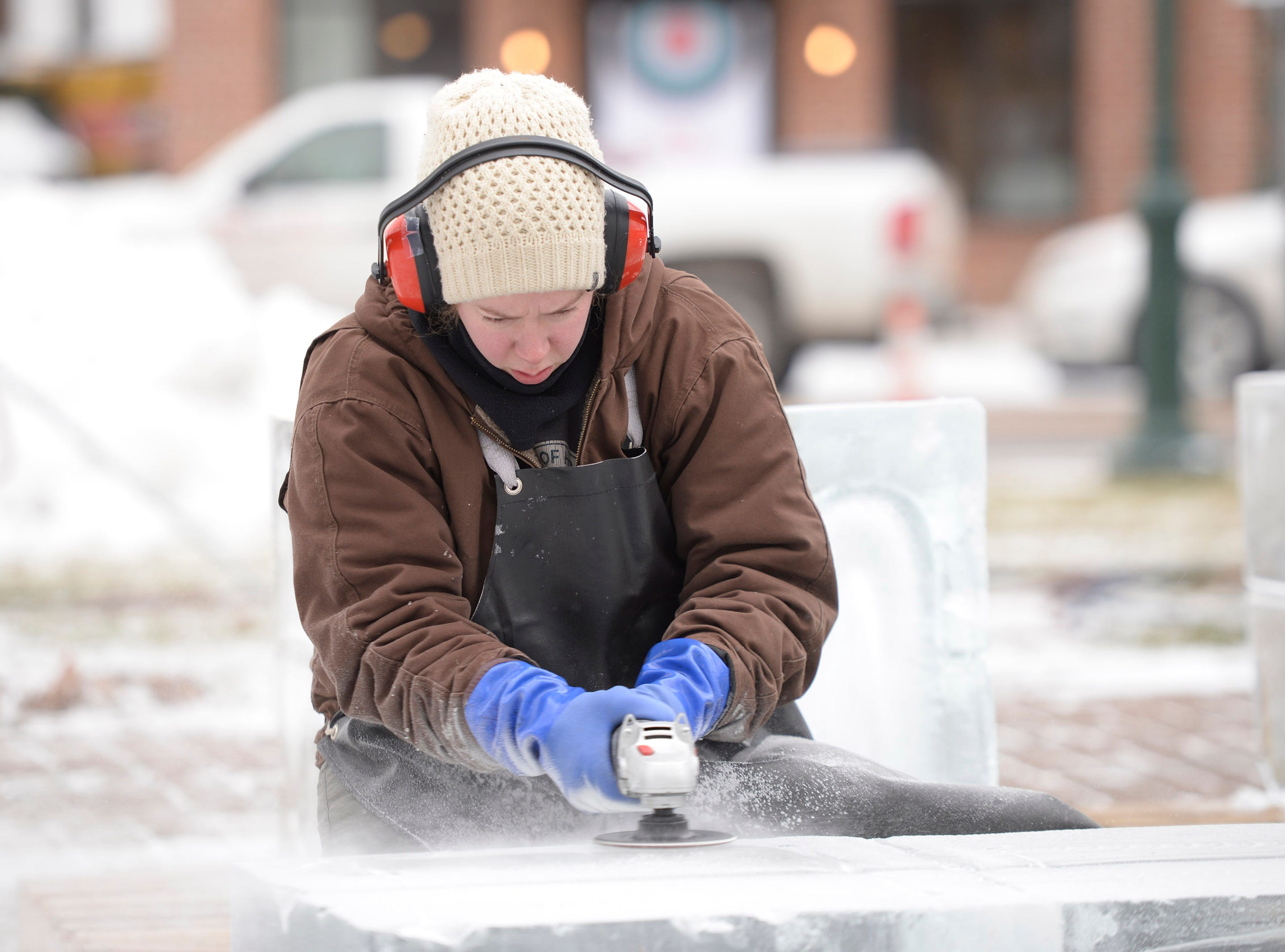 Lauren Klapar from Clear Cut Ice prepares a base set of ice blocks for a sculpture on Wednesday, Jan. 9, 2019.