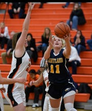 Hartland's Amanda Roach (11) drives by Northville's Nicole Martin (24) during a KLAA West Division matchup on Jan. 8, 2019.