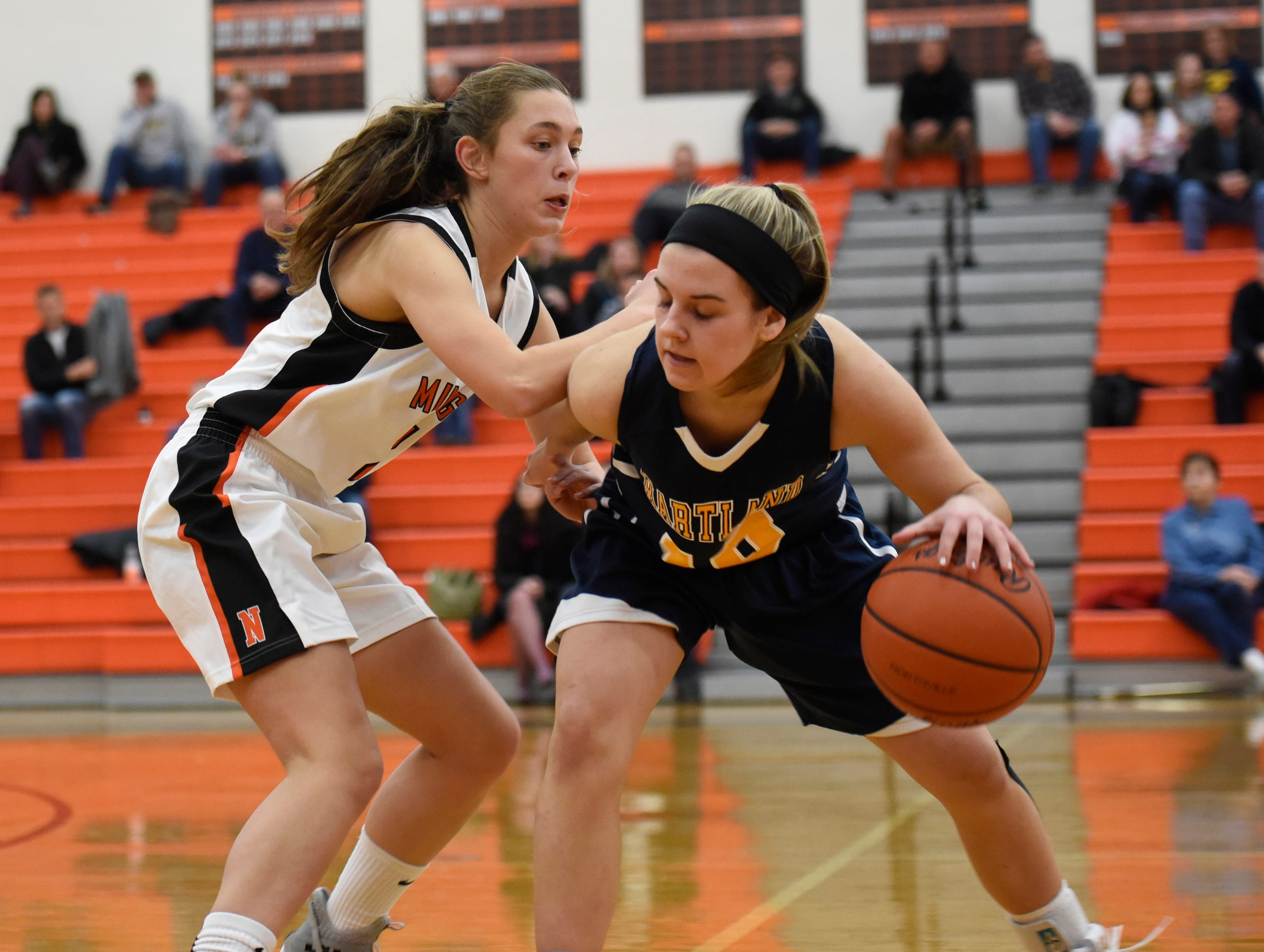 Hartland's Nikki Dompierre (10) and Northville's Sophia Jeromsky (21) during a KLAA match up between the Mustangs and Eagles at Northville Jan. 8, 2019