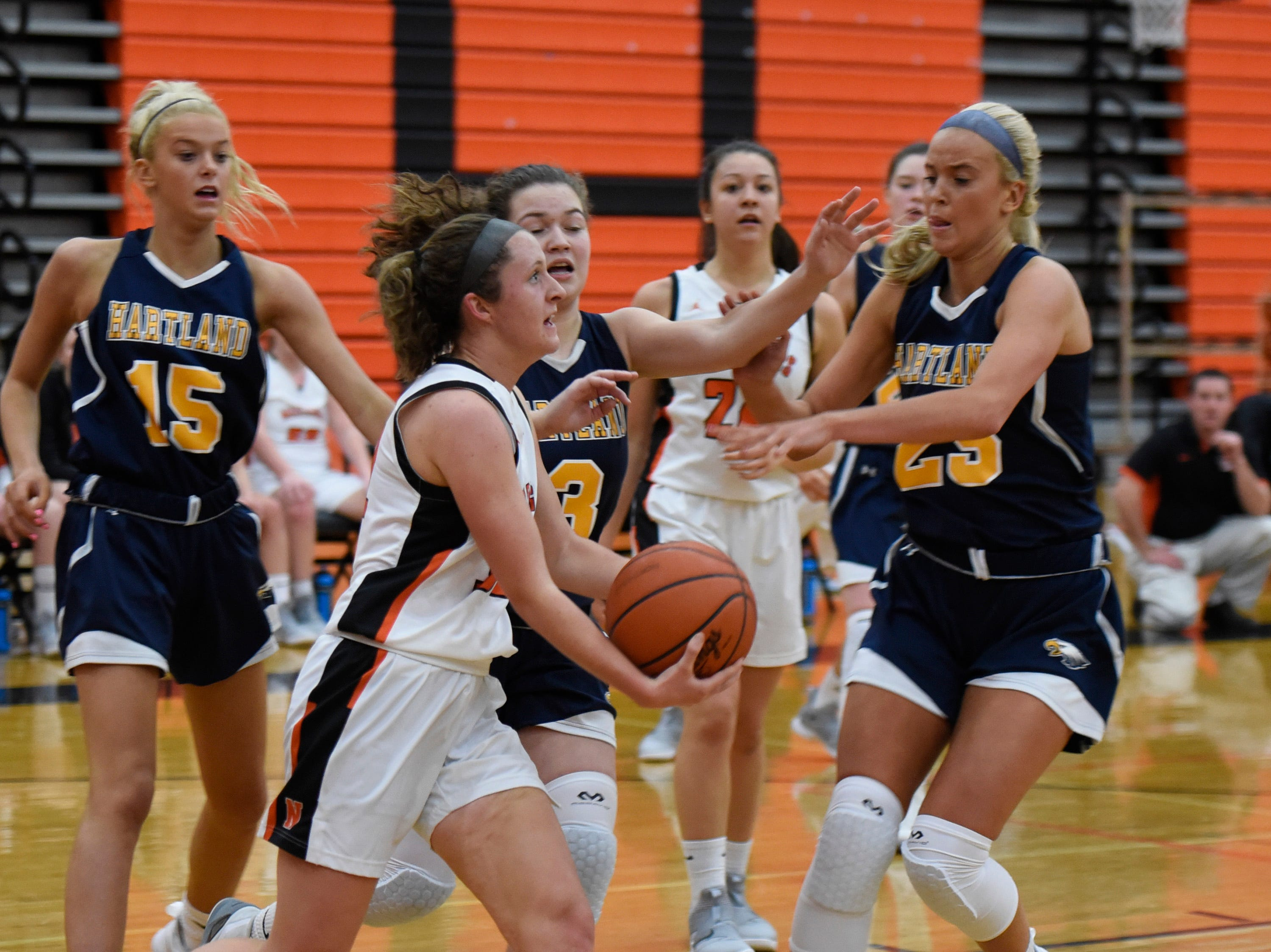 Northville's Ellie Thallman (32) and Hartland's Whitney Sollom (25) during a KLAA match up between the Mustangs and Eagles at Northville Jan. 8, 2019