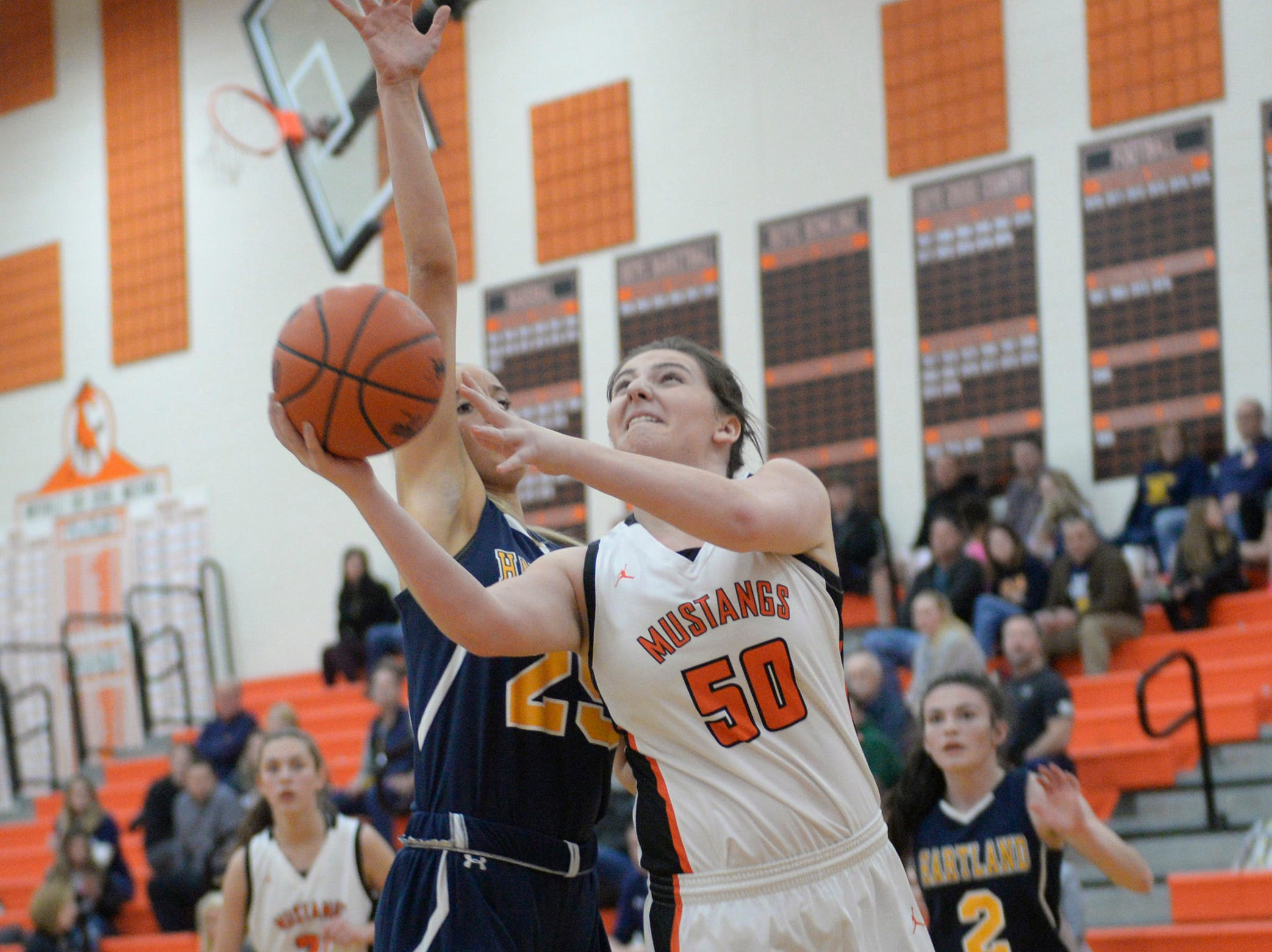 Northville's Julia Straky (50) is guarded by Hartland's Whitney Sollom (25) during a KLAA match up between the Mustangs and Eagles at Northville Jan. 8, 2019