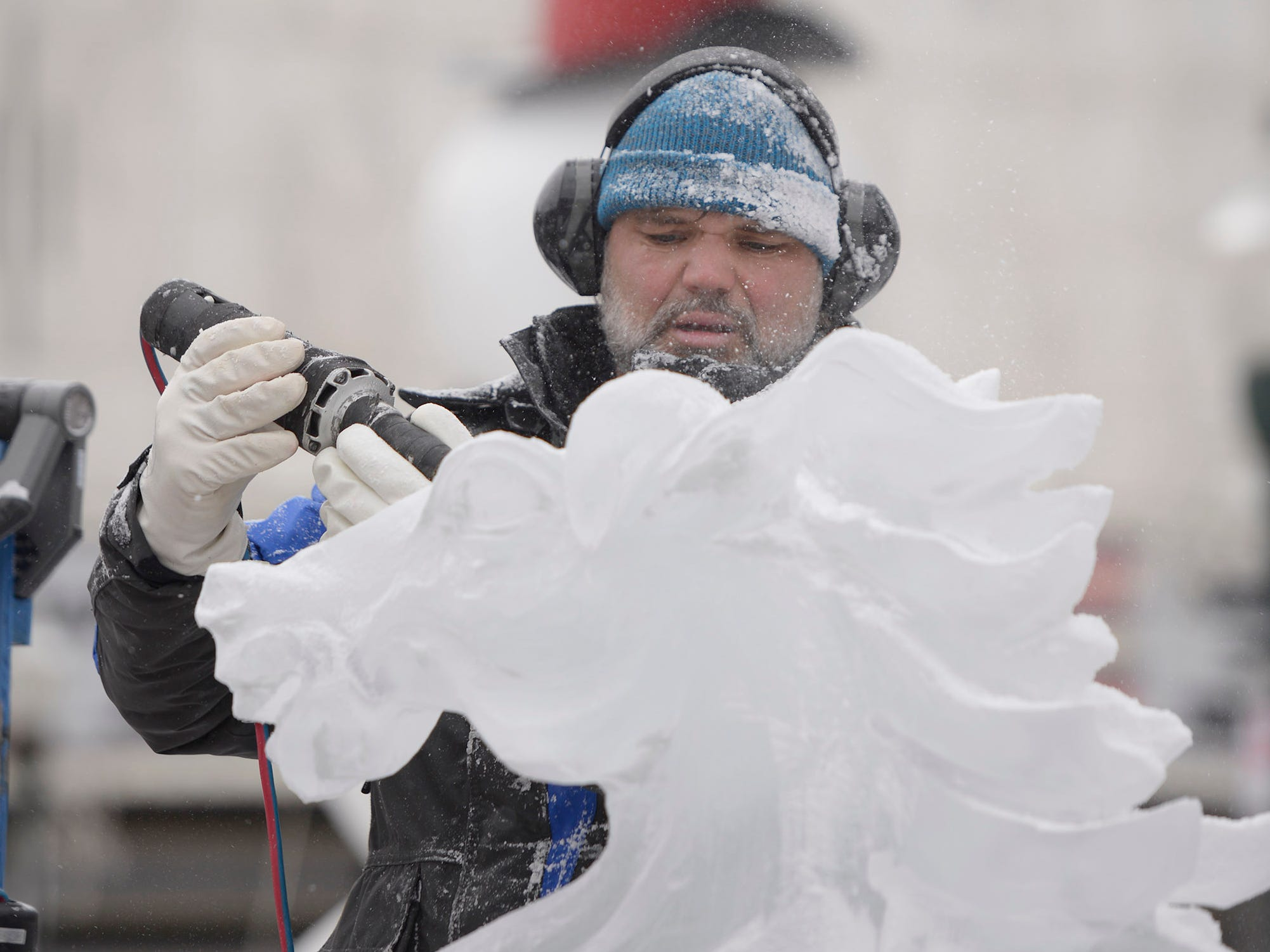 Aaron Costick from Elegant Ice Creations carves a horse head that will part of the main feature consisting of 14 blocks of ice, on Jan. 9 before the opening of the Plymouth Ice Festival that runs Jan. 11-13.