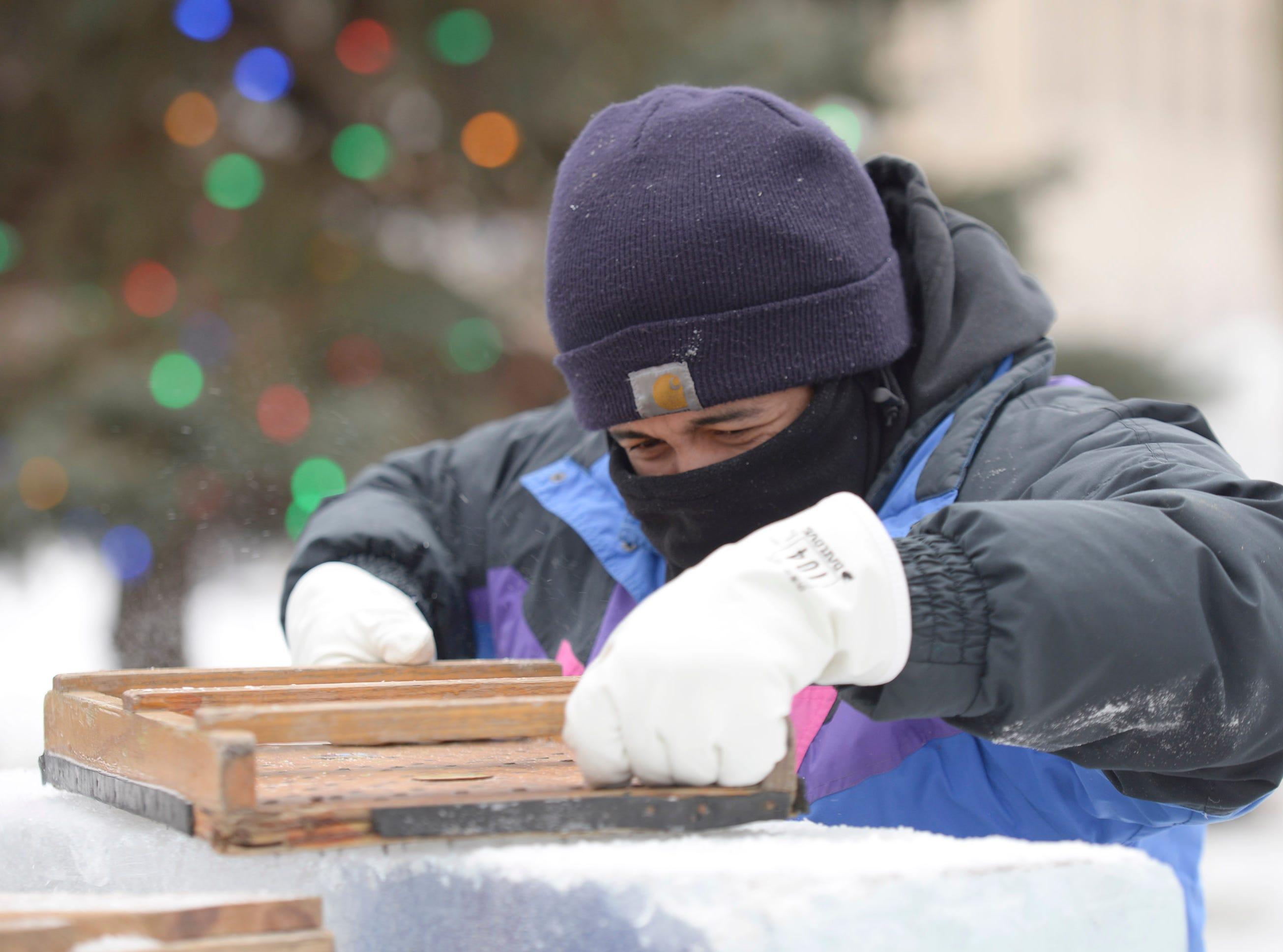 Brett Fuqua prepares blocks of ice for carving at the Plymouth Ice Festival that runs Jan. 11-13.