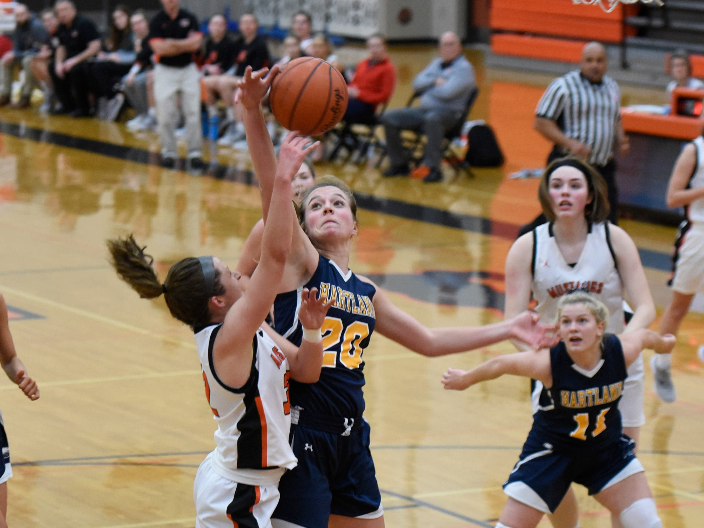 Hartland's Lillee Gustafson (20) blocks a lay up by Northville's Ellie Thallman (32) during a KLAA match up between the Mustangs and Eagles at Northville Jan. 8, 2019