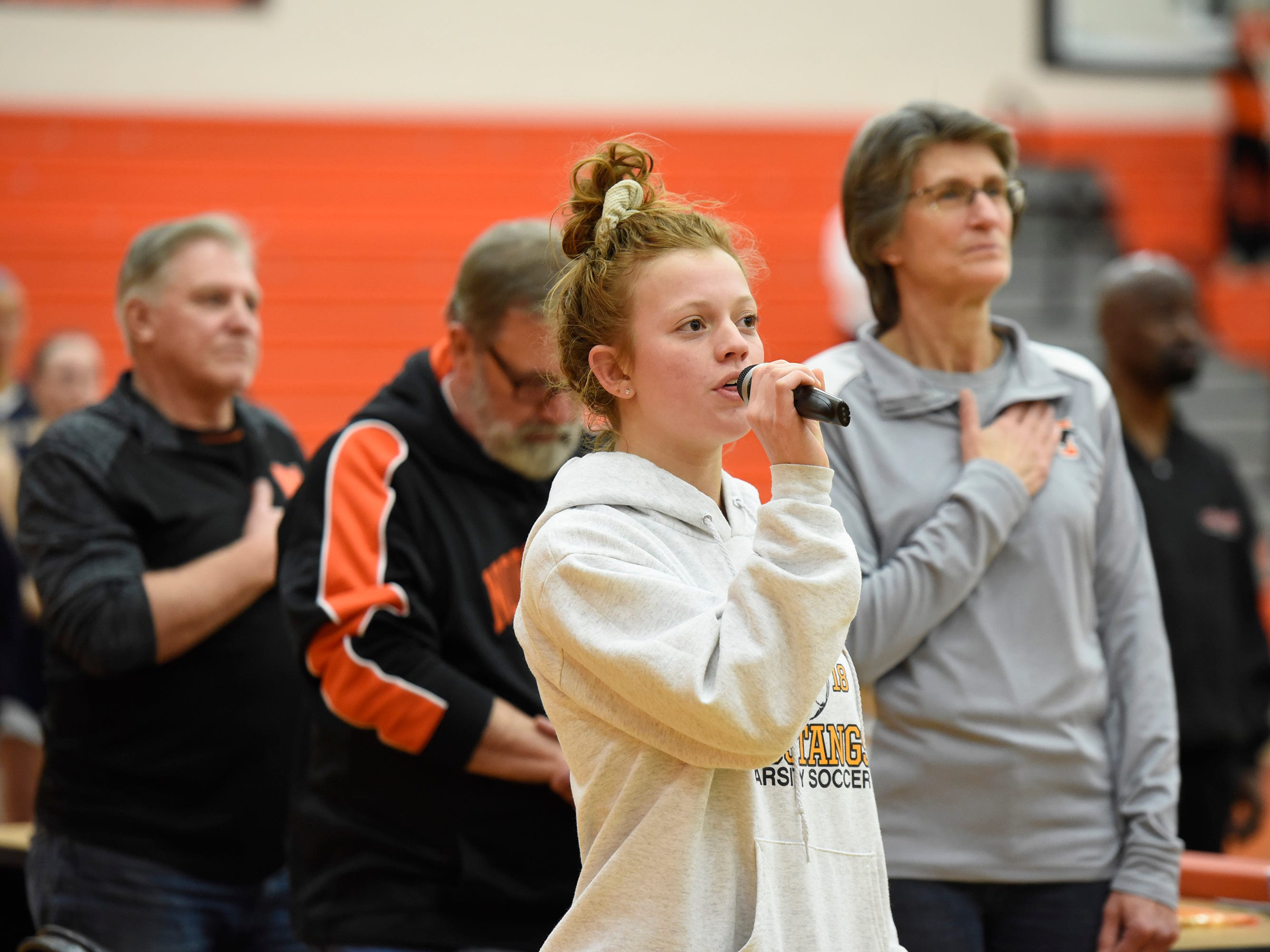 National anthem before the start of Hartland at Norhtville basketball game Jan. 8, 2019