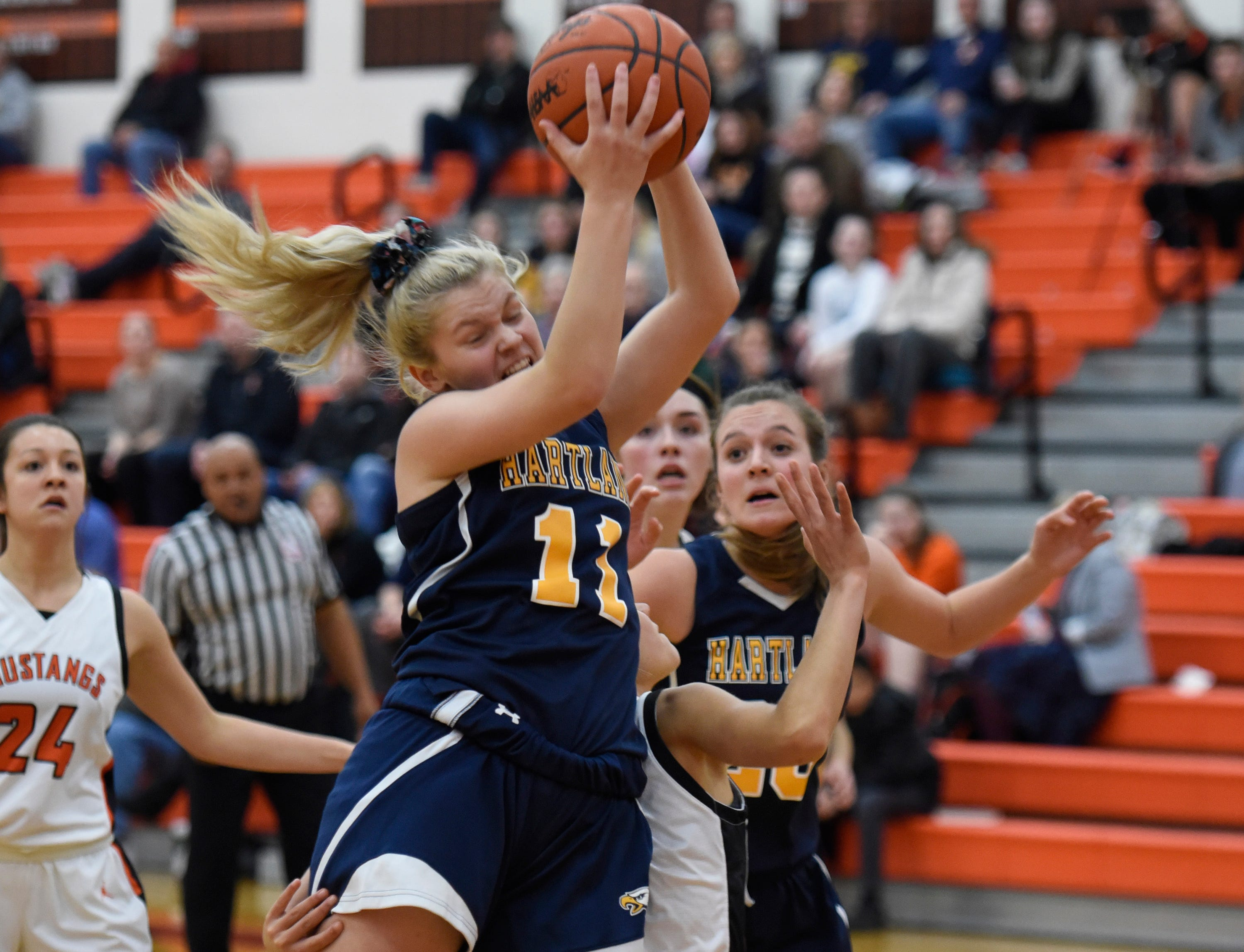 Hartland's Amanda Roach (11) grabs a rebound during a KLAA match up between the Mustangs and Eagles at Northville Jan. 8, 2019