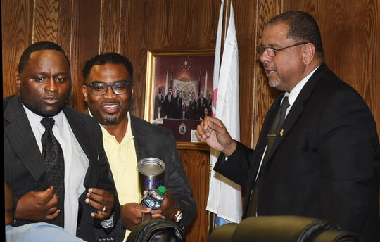 From left, Aldermen Marvin Richard, Floyd Ford and Mayor Julius Alsandor get ready for the first city council meeting of the new administration.