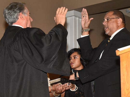 Julius Alsandor is sworn in as mayor of the city of Opelousas by Judge Jimmy Genovese during swearing in ceremonies held Sunday at the Opelousas Civic Center.
