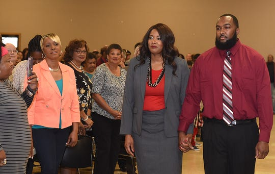 Newly elected Opelousas Councilwoman Chasity Davis prepares to take her oath of office during swearing in ceremonies Sunday at the Opelousas Civic Center.
