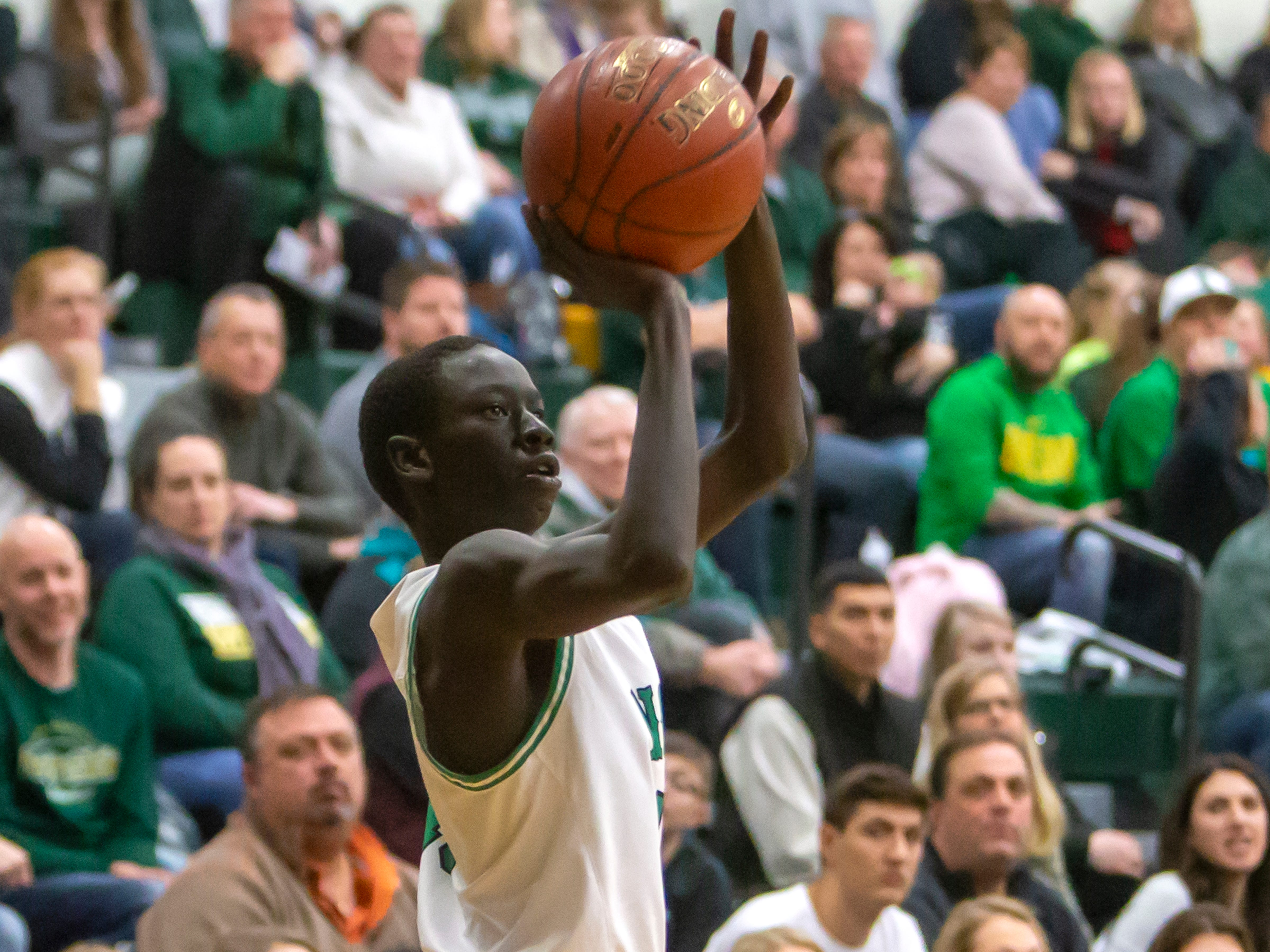 Oshkosh North's Garang Deng shoots during a game against the Wildcats at the Oshkosh North High School on Tuesday, Jan. 8, 2019.