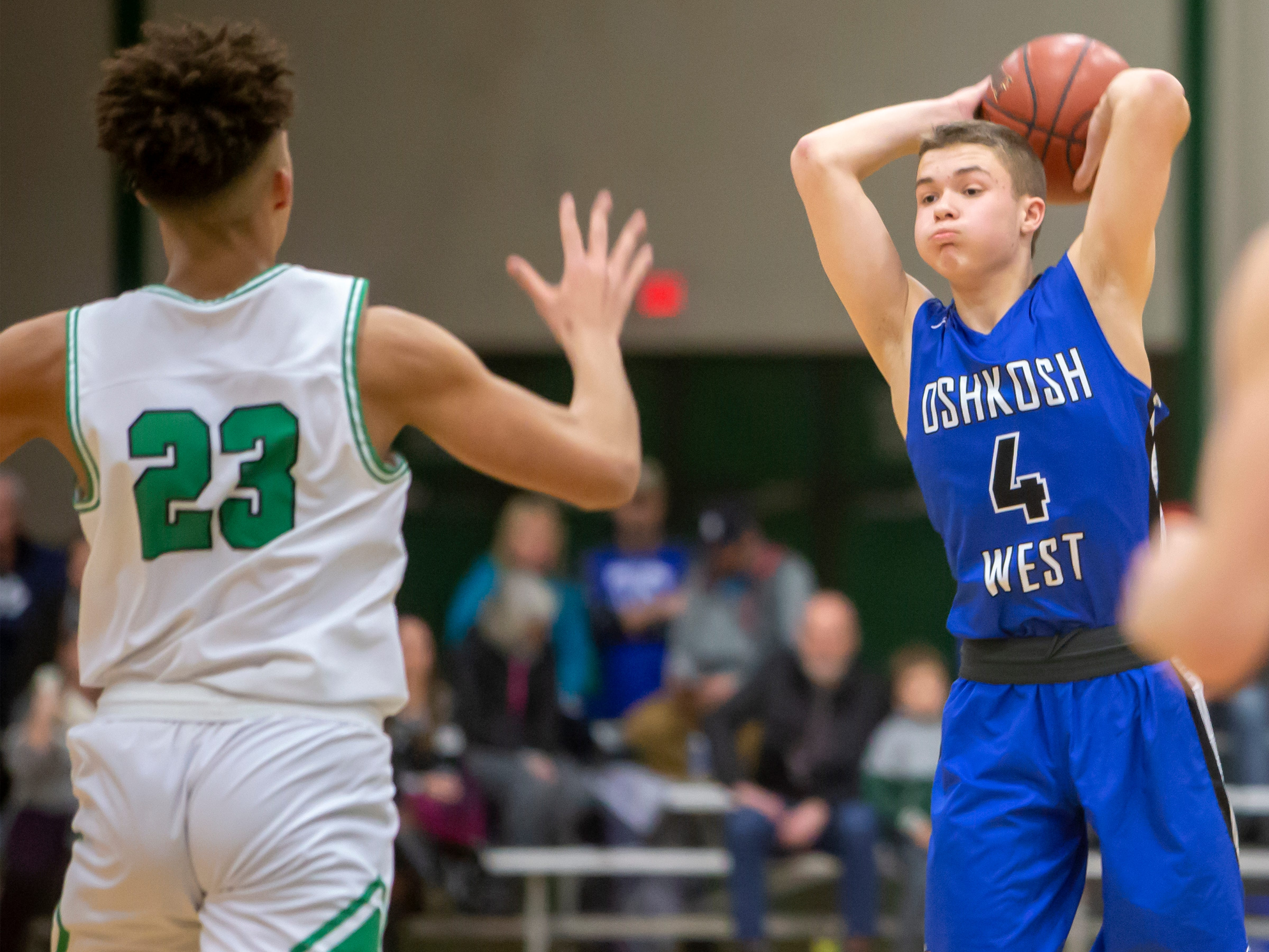 Oshkosh West's Riley Frey throws a pass playing against the Spartans at the Oshkosh North High School on Tuesday, Jan. 8, 2019.