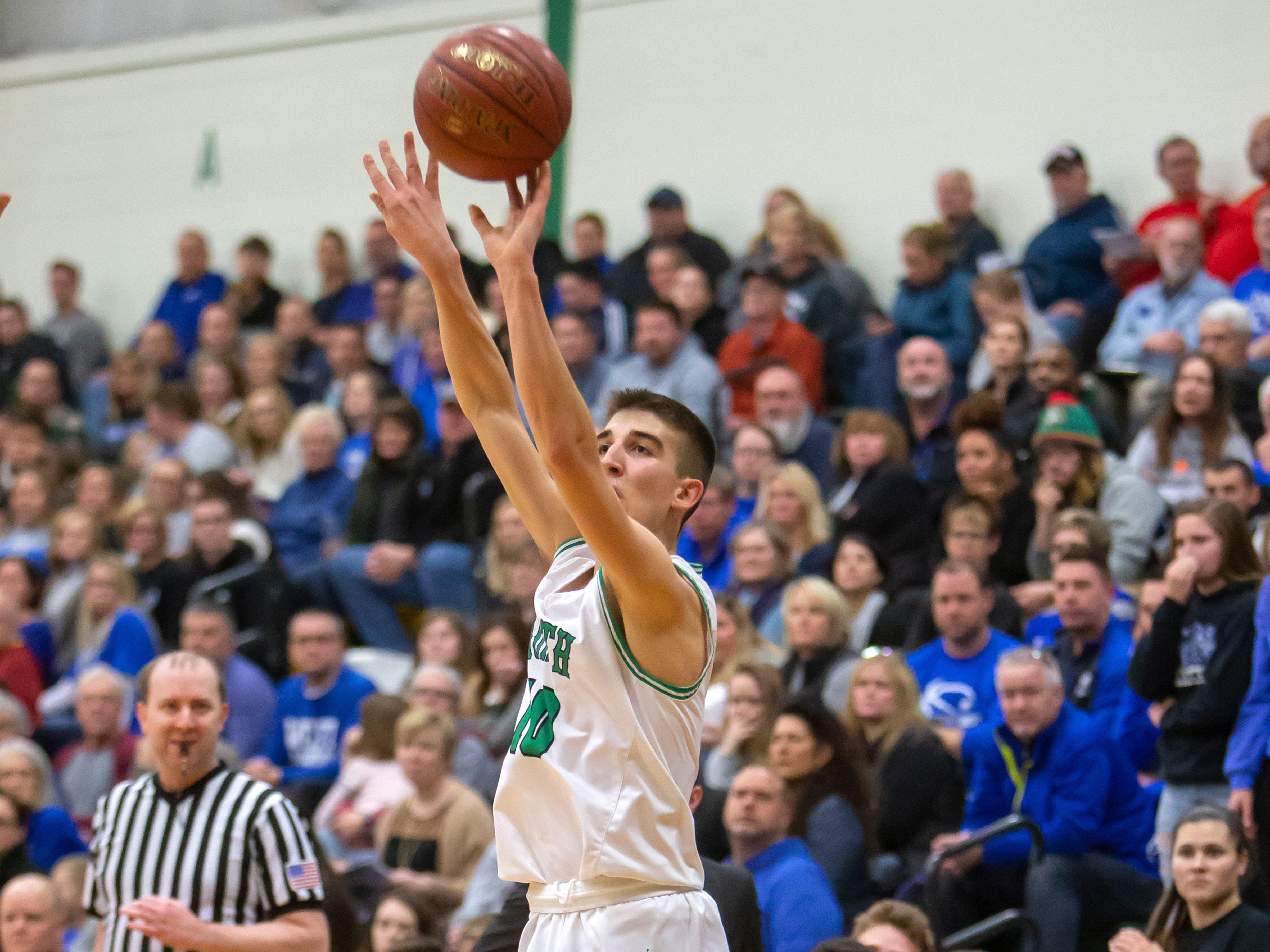 Oshkosh North's Josh Dilling shoots a 3-pointer during a game against the Wildcats at the Oshkosh North High School on Tuesday, Jan. 8, 2019.