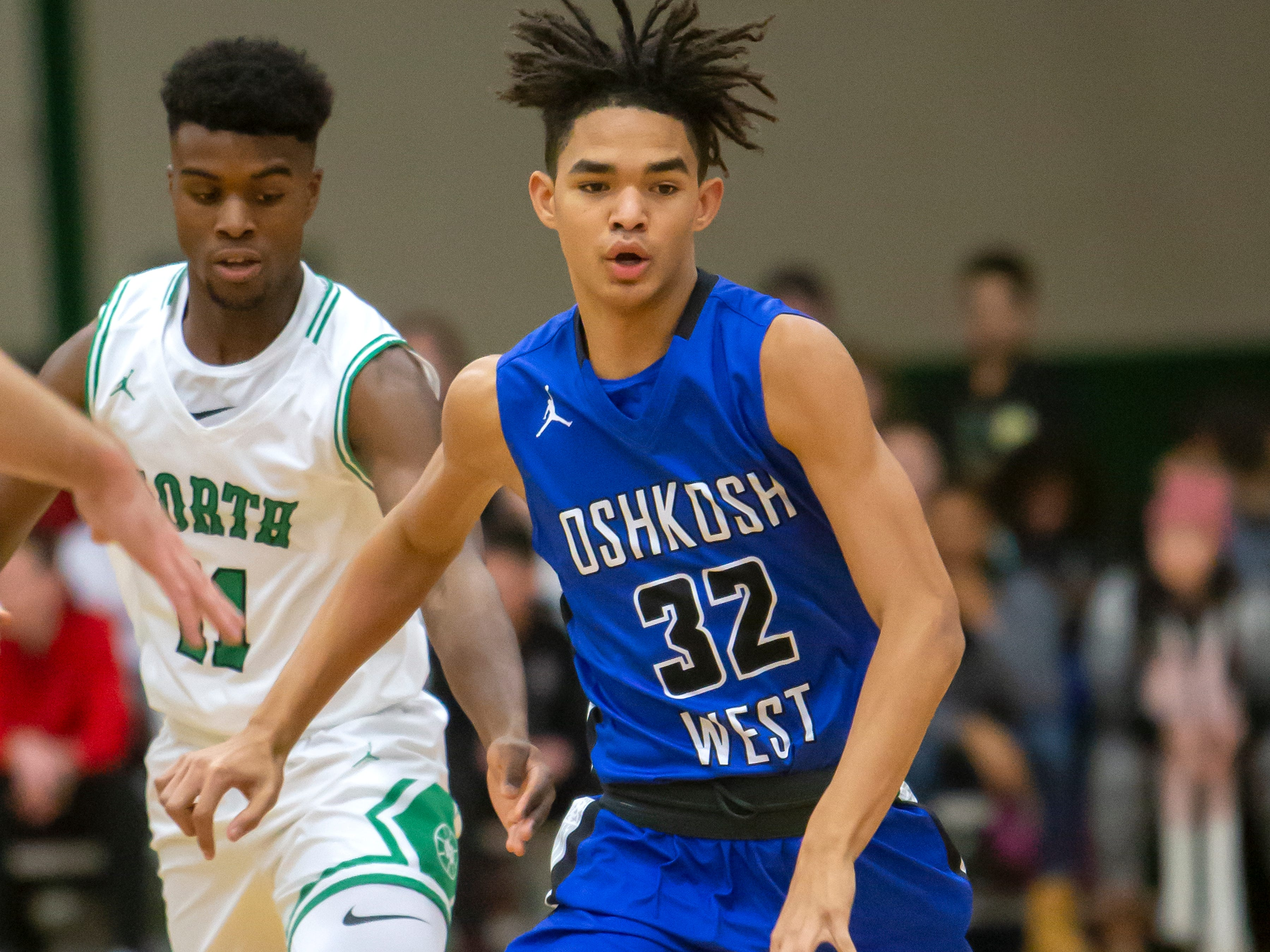 Oshkosh West's Jacquez Overstreet dribbles the ball across the court playing against the Spartans at the Oshkosh North High School on Tuesday, Jan. 8, 2019.