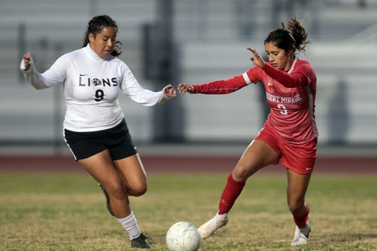 The Lions' Alex Fernandez and the Rams' Fabiana Zavala battle for the ball on Tuesday, January 8, 2018 in Thermal.