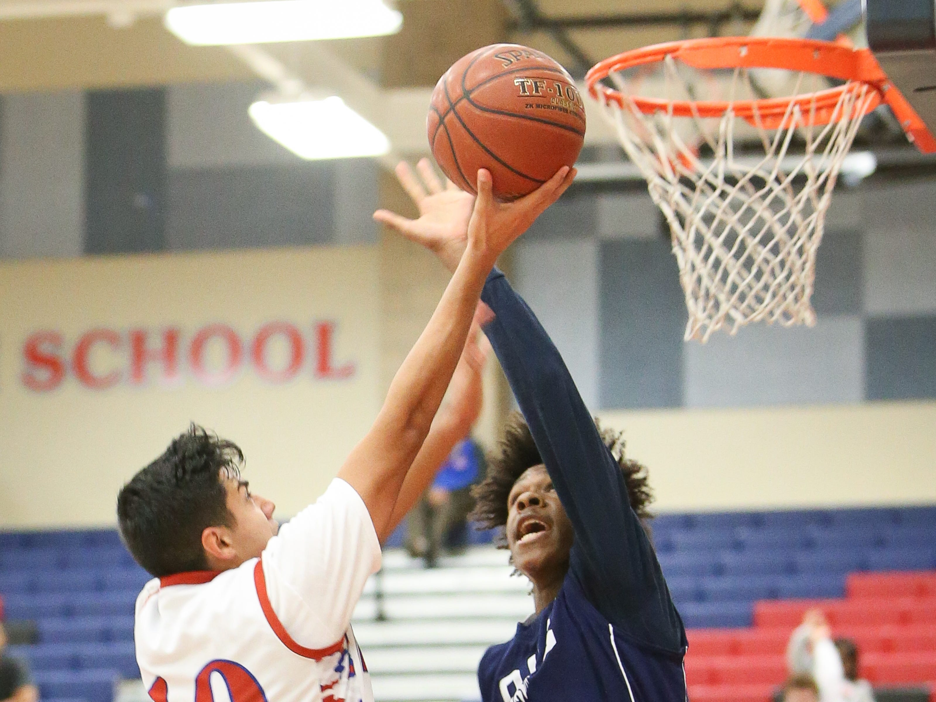 Jose Briceno attempts a layup but was blocked. The Indio varsity basketball team won Tuesday's home conference game against Desert Hot Springs (CA) by a score of 64-59.