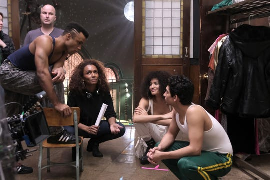 "Pictured left to right on the set of ""Pose"" are Dyllon Burnside as Ricky; producer/writer/director Janet Mock; Indya Moore as Angel; and Angel Bismark Curiel as Lil Papi"