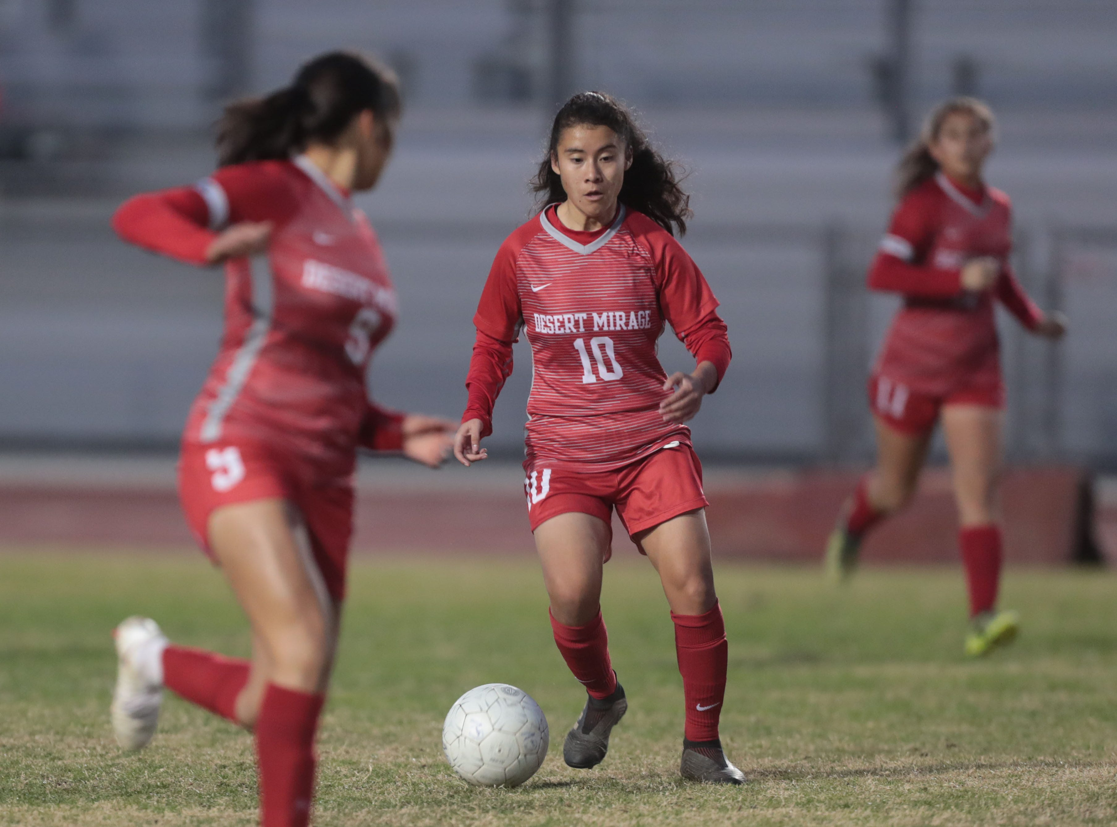 Rams' Yisel Ybarra moves the ball forward against the Lions on Tuesday, January 8, 2018 in Thermal.
