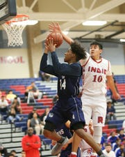 Anthony Watson of DHS is defended by Junior Briceno of Indio on Tuesday. Indio won 64-59.