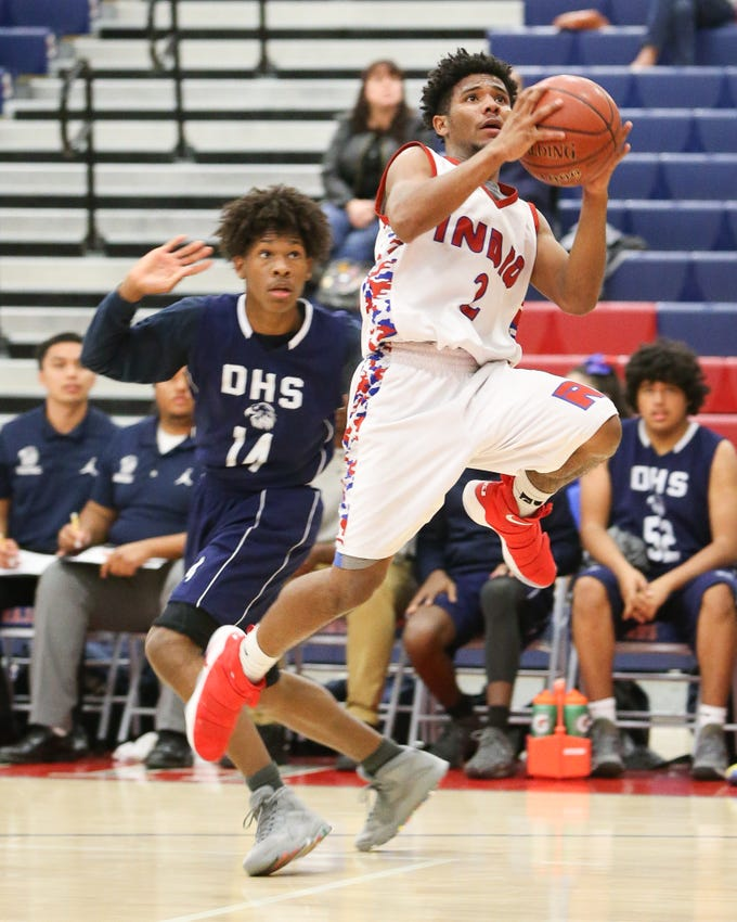 Isaiah Riley drives past a player for a jump shot. The Indio varsity basketball team won Tuesday's home conference game against Desert Hot Springs (CA) by a score of 64-59.