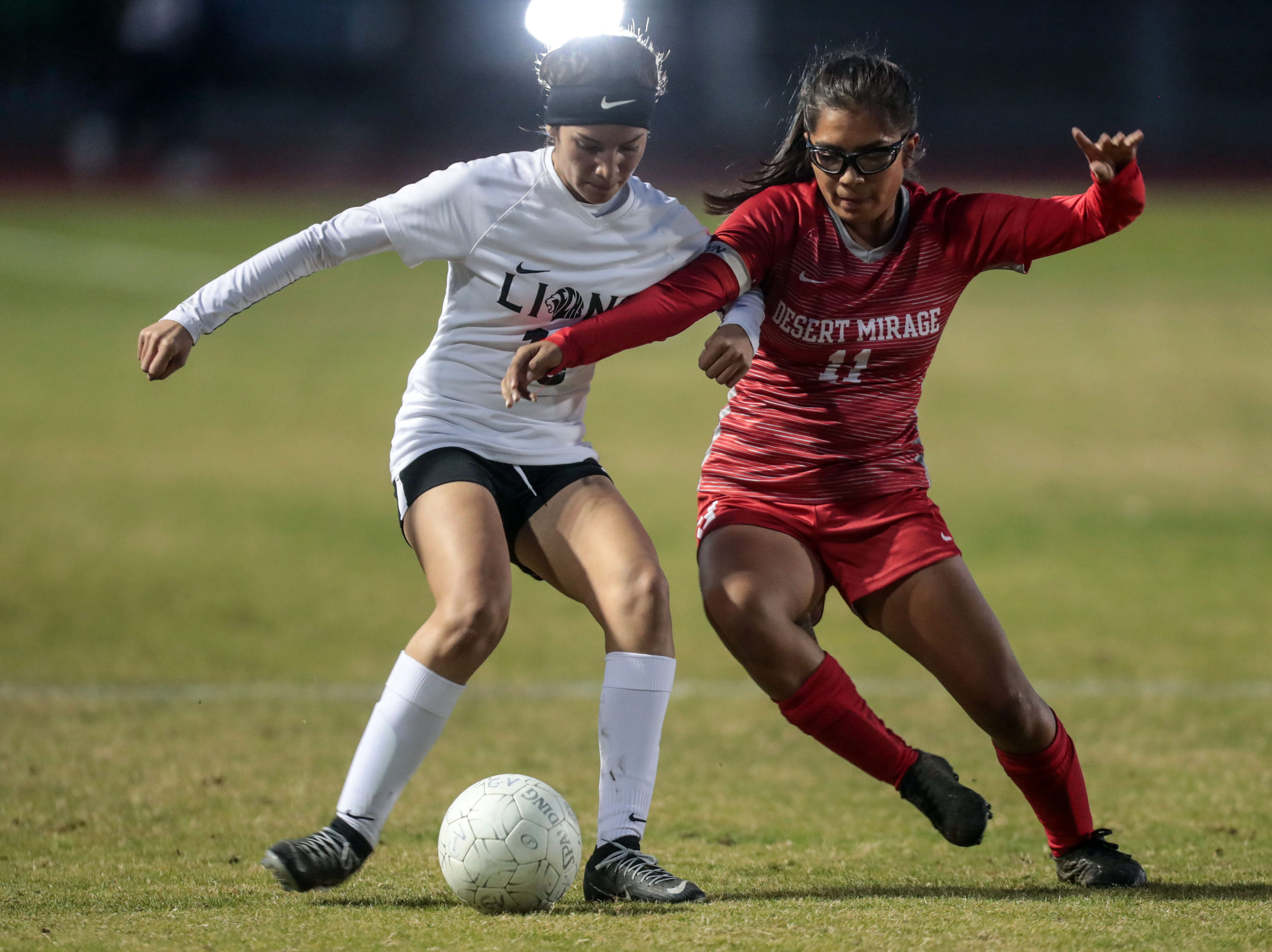 The Lions' Alondra Uribe and the Rams' Anastasia Cruz battle for the ball on Tuesday, January 8, 2018 in Thermal.