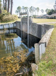 Escambia County wanted to take control of this flood gate along Lake Joanne Drive in Pensacola. The flood gate controls the water levels in Lake Charlene and Lake Joanne.