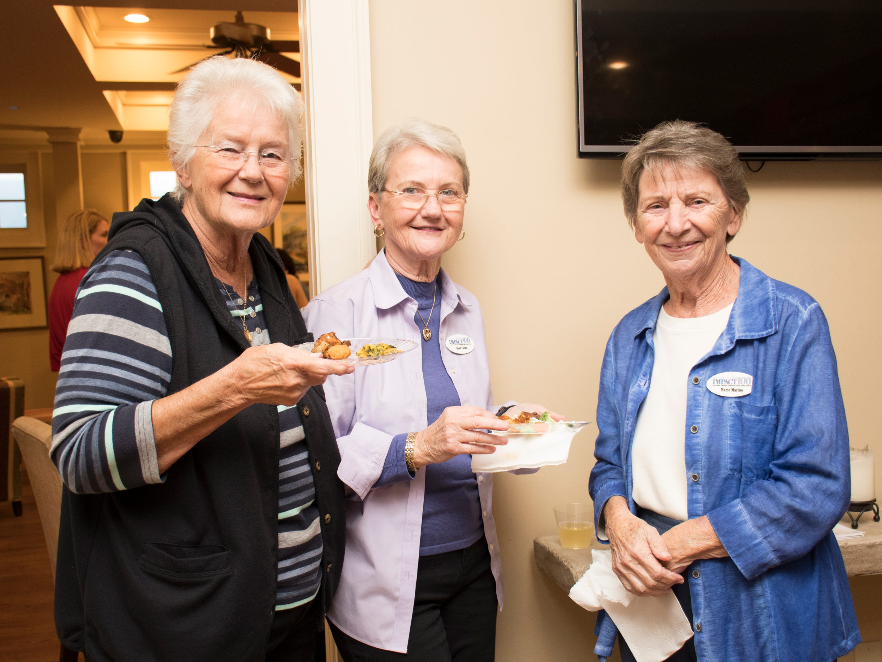 Jackie Wills, from left, Dona Cotten, and Marie Marino during the Impact 100 Pensacola Bay Area meeting at the Lee House in Pensacola on Tuesday, January 8, 2019.