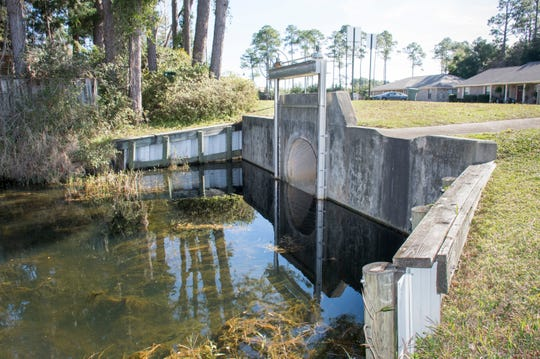 Escambia County is looking to take control of this flood gate along Lake Joanne Drive in Pensacola. The flood gate controls the water levels in Lake Charlene and Lake Joanne.