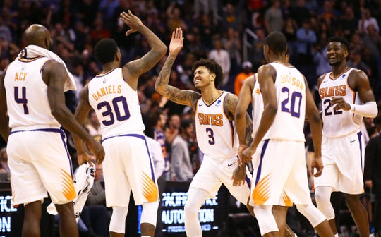 Kelly Oubre Jr. celebrates with his Suns teammates after their come-from-behind victory against the Kings on Jan. 8 at Talking Stick Resort Arena.