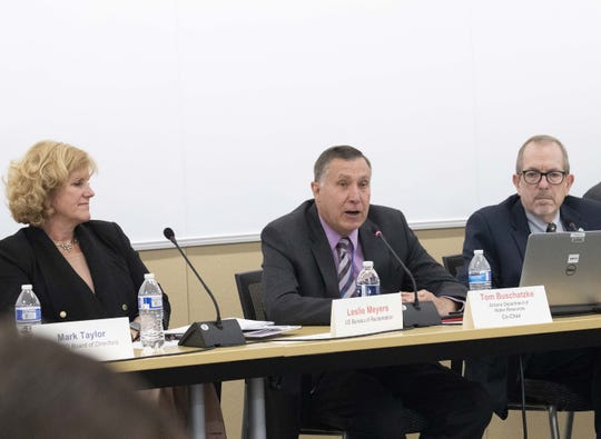 Officials including Leslie Meyers of the U.S. Bureau of Reclamation (left); Arizona Department of Water Resources director Tom Buschatzke (center); and Central Arizona Project general manager Ted Cooke talk about the proposed Colorado River drought plan during a meeting in Phoenix on Jan. 8, 2019.
