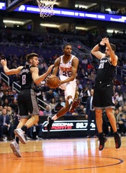 Suns forward Mikal Bridges looks to pass during a game Jan. 8 against the Kings at Talking Stick Resort Arena.