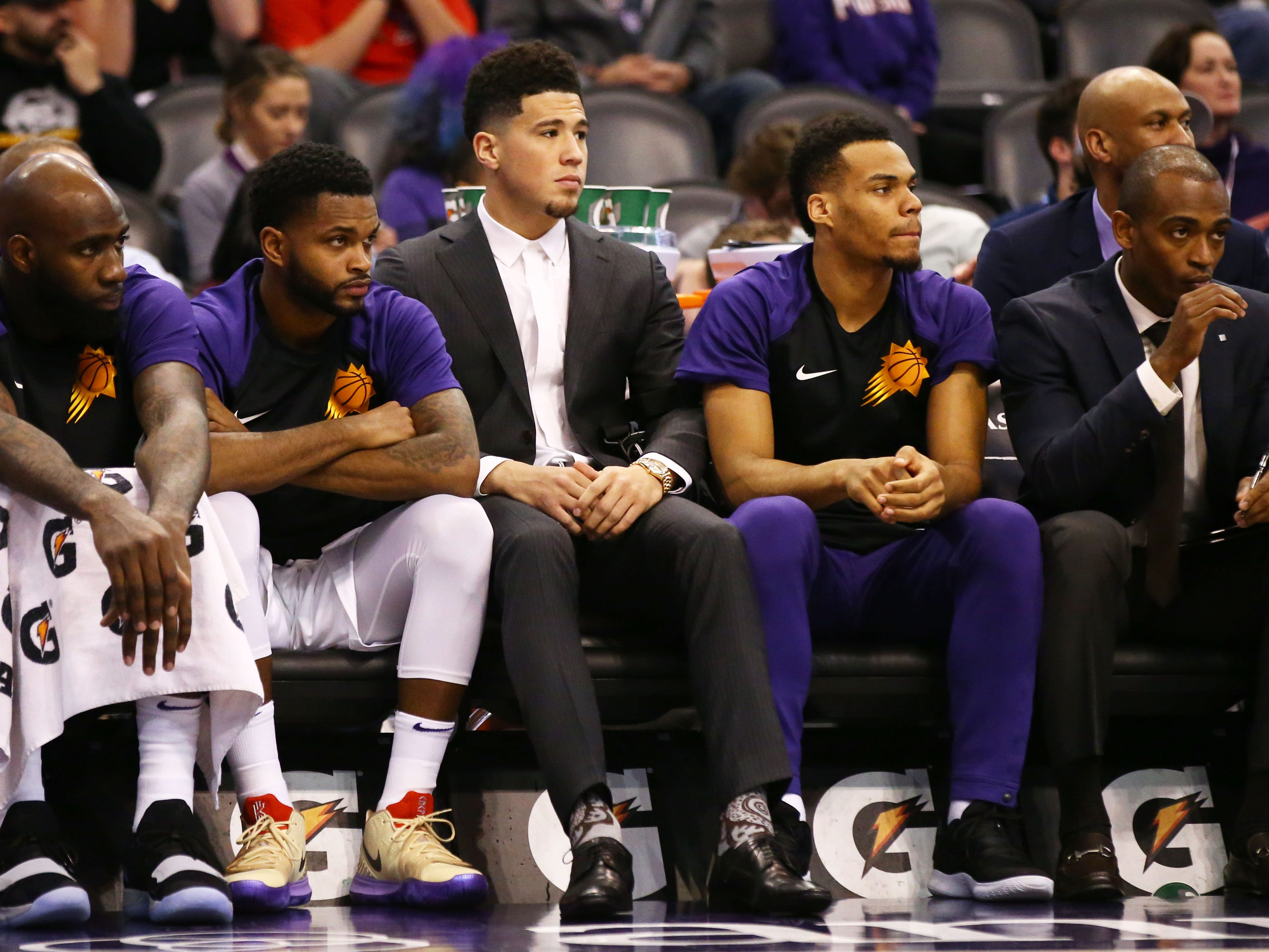 Phoenix Suns guard Devin Booker sits-out the game with injury against the Sacramento Kings in the first half on Jan. 8 at Talking Stick Resort Arena.