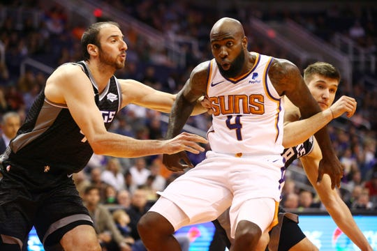 Phoenix Suns forward Quincy Acy (4) battles for position with Sacramento Kings center Kosta Koufos (left) in the first half on Jan. 8 at Talking Stick Resort Arena.