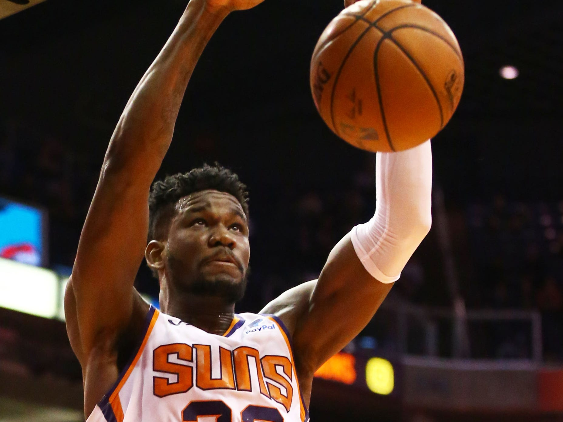 Phoenix Suns center Deandre Ayton dunks the ball against the Sacramento Kings in the first half on Jan. 8 at Talking Stick Resort Arena.