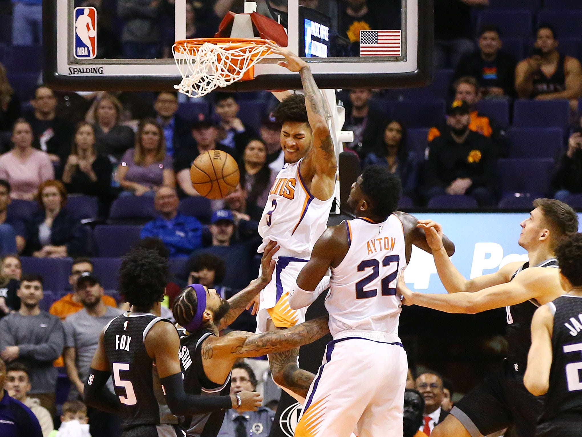 Phoenix Suns forward Kelly Oubre Jr. (3) slam-dunks the ball against the Sacramento Kings in the second half on Jan. 8 at Talking Stick Resort Arena.