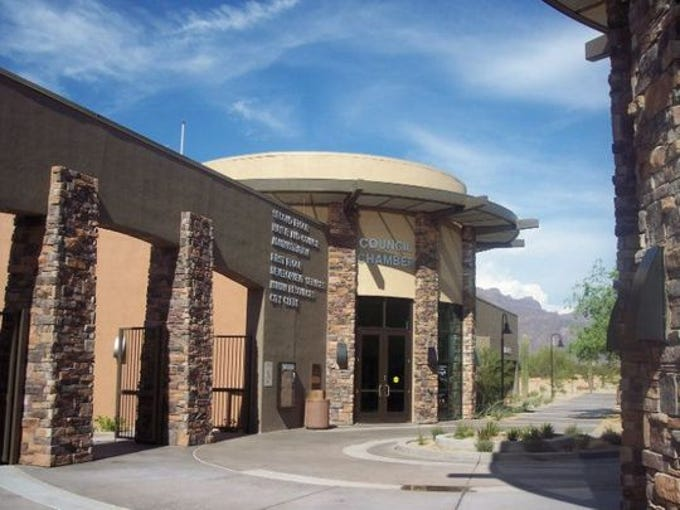 Construction for the $7 million stucco building began in March 2004 and completed a year later. The adobe-like building was designed to complement the natural environment and mimic the nearby Superstition Mountains, providing interaction with wildlife, minimal disruption to the environment and great natural views. It was the first city hall in the state to receive LEED (Leadership in Energy & Environmental Design) certification for its lighting and energy management system. The 48,000-square-foot building has two floors and houses the City Clerk's office, the City Attorney's office, the Municipal Court and management and development services.