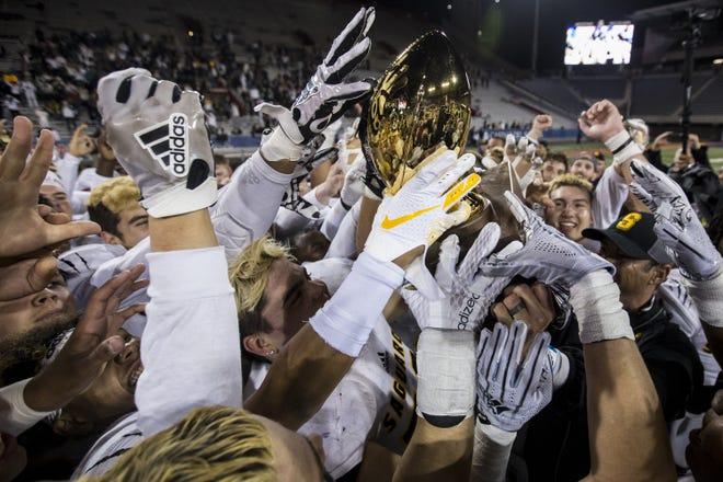 Saguaro celebrates after defeating Salpointe for the 4A State Championship on Friday, Nov. 30, 2018, at Arizona Stadium in Tucson, Ariz. Saguaro won, 42-16.