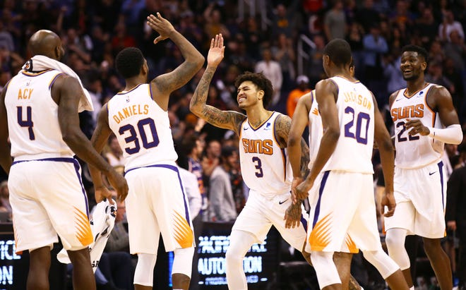 Phoenix Suns forward Kelly Oubre Jr. (3) celebrates during their come from behind 114-111 win over the Sacramento Kings in the second half on Jan. 8 at Talking Stick Resort Arena.